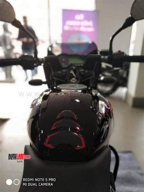 bajaj pulsar  neon red silver yellow launched price