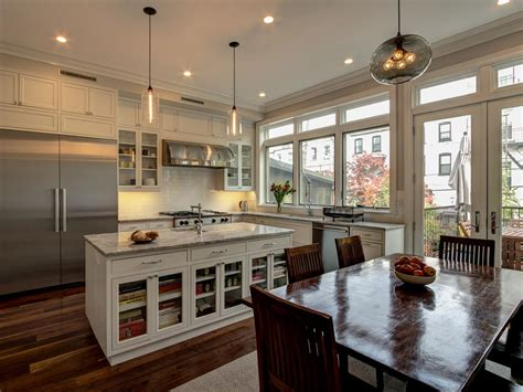 transitional white kitchen boasts variegated wood floor hgtv