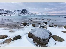 Icy rocks on the shore of the beach at Grotfjord, Norway