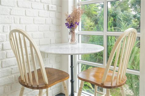 Window Sill Table by Vintage Chair And Table And Window Sill In Background