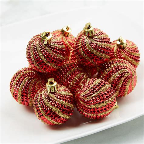 red  gold swirl christmas ornaments christmas