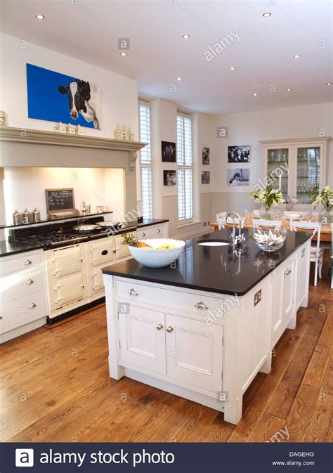 country white kitchens island unit in modern white country kitchen with white aga 2968