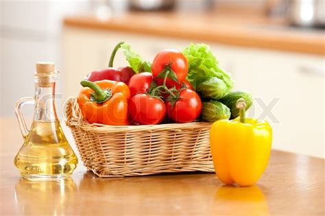 kitchen vegetable cutting table healthy food fresh vegetables in basket and bottle with