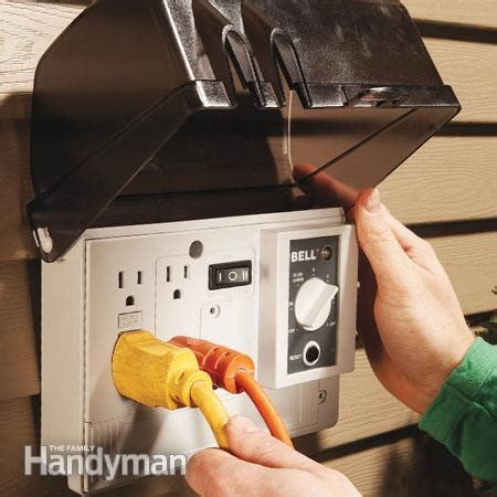 outdoor light with electrical outlet how to add an outdoor outlet the family handyman