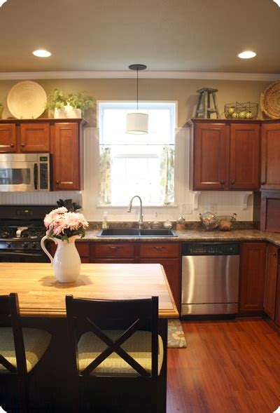 decorating above kitchen cabinet space how to decorate above kitchen cabinets from thrifty decor