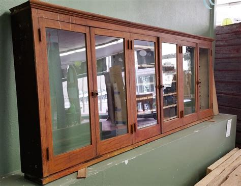 upper cabinet  glass doors crescent moon antiques
