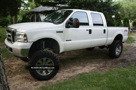 lifted  ford   duty  lariat crew cab pickup  door