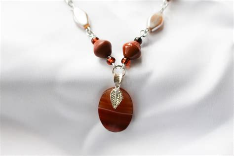 hanging earrings orange agate pendant on spicecolor beaded necklace by