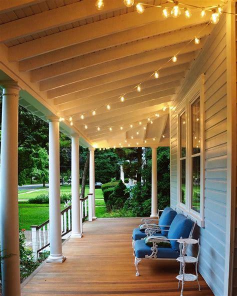 restored victorian wrap around porch string cafe lights