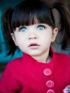 dark hair and blue eyes! This little girl is beautiful ...