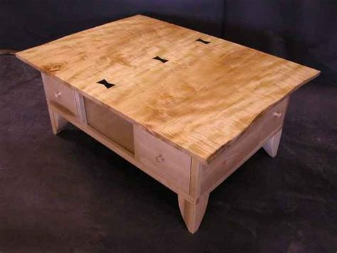 Custommade coffee tables are handcrafted by expert craftsmen with quality made to last. Rustic Curly Maple Slab Coffee Table with Ebony Butterflies