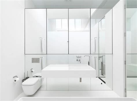 Mirrored Wall Bathroom by 10 Rooms With A Mirrored Wall