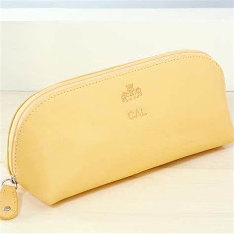 monogrammed leather cosmetic bag