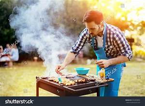 Handsome Male Preparing Barbecue Outdoors Friends Stock Photo 443409892 - Shutterstock