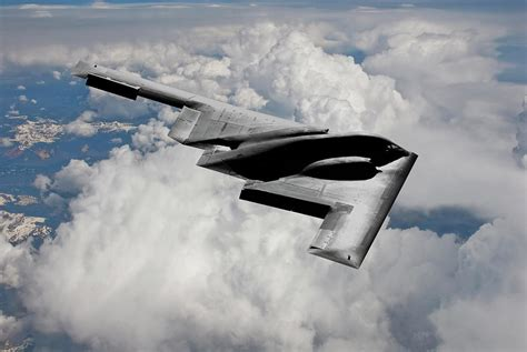 Stealth Bomber Over the Clouds Mixed Media by Erik Simonsen