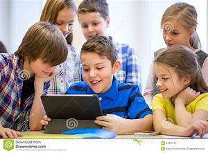 Group Of School Kids With Tablet Pc In Classroom Stock ...