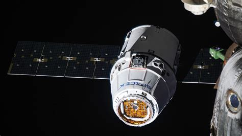 Crs-14 Dragon Berths With International Space Station