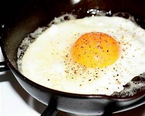 Fried eggs (not scrambled) in a Stainless Steel or a Cast ...
