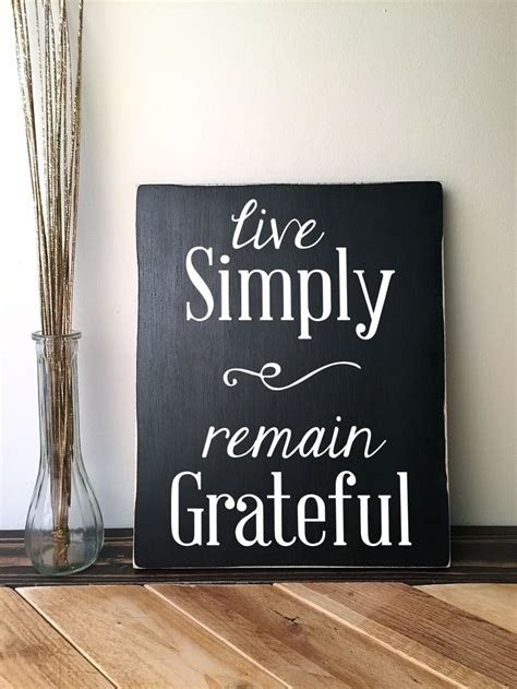 handmade wooden sign  quote  simply remain