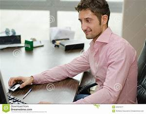 Handsome, Happy Office Worker Smiling While Using Computer ...