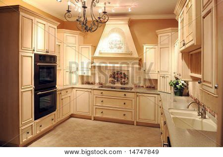 beautiful modern kitchen with light colored cabinets and