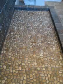 bathroom shower floor tile ideas 31 great ideas and pictures of river rock tiles for the bathroom