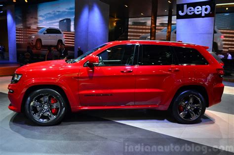 jeep grand cherokee srt red jeep grand cherokee srt red vapor side at the 2014 paris