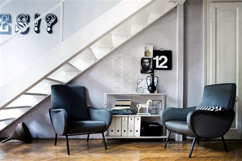 living room  black chairs   stairs interior