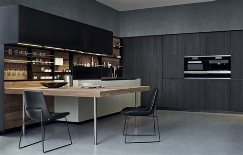 steel and wood kitchen with peninsula by varenna