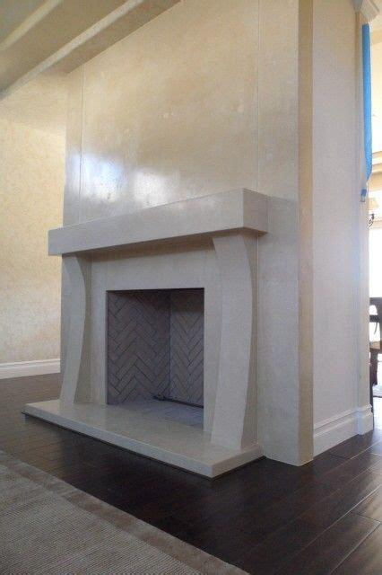 hand  concrete fireplace surround  stonenv