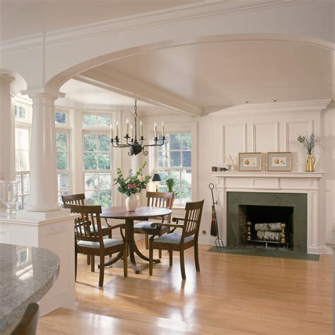 white kitchen  breakfast room  fireplace  arches
