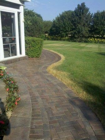 unilock walkway after being sealed with look sealer by - Unilock Paver Sealer