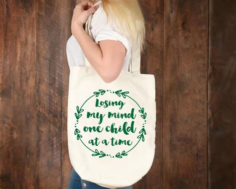 Slim (consider ordering a larger size for a looser fit). Losing my mind one child at a time mom svg mom life svg   Etsy