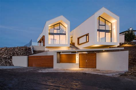 Minimalist House-Shaped House with Traditional Gabled