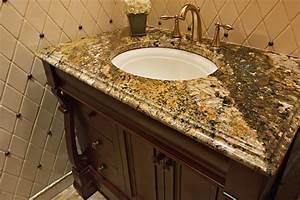 Guest bathroom granite countertop with single vanity