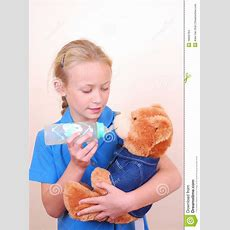 Little Girl Playing With Teddy Bear Stock Photo  Image Of