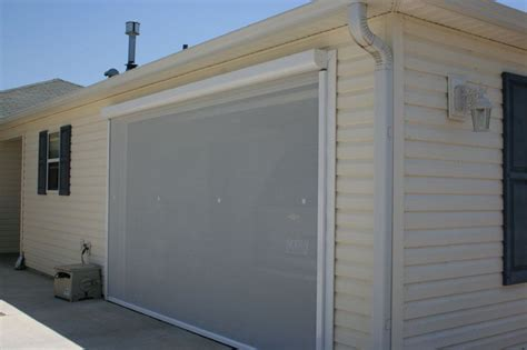 electric roll up garage screens michele s hide away screens