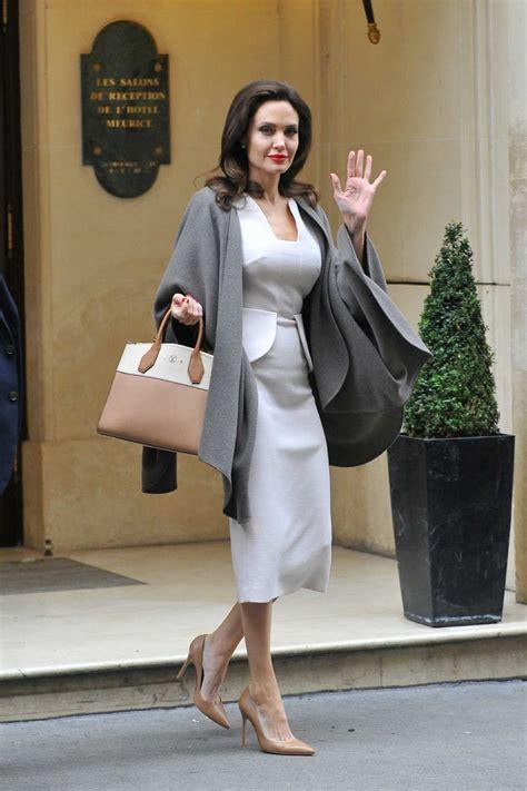 angelina jolie leaves  hotel  paris