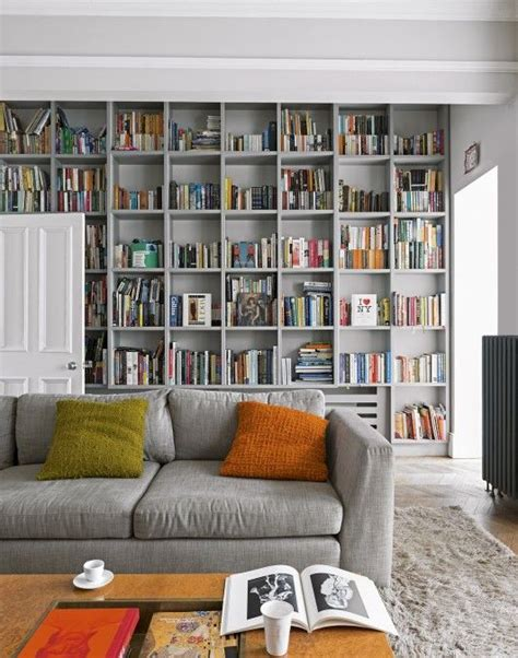 Living Room Furniture Home Depot by This Grey Living Room With Floor To Ceiling Bookcases Uses
