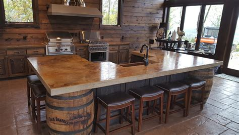 Whiskey Themed Kitchen With Barrels And A Concrete