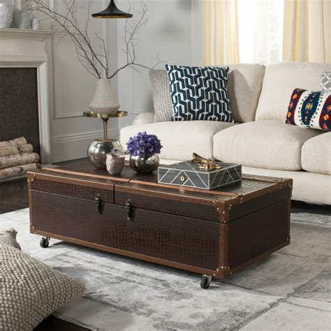 Sturdy coffee table used in the conservatory with two baskets beneath for storage of the grandchildren s play things when visiting or if preferred just for storing magazines. Chadwick Leather Storage Trunk Coffee Table, Espresso Brown - BrandAlley