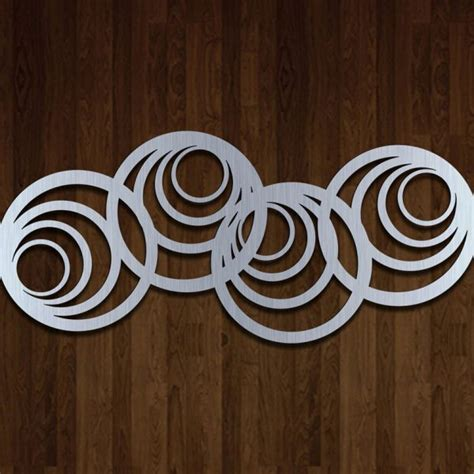 But filling up walls can be an expensive endeavor, especially if you have a lot of empty space to cover. Modern Abstract Circle Metal Wall Art Hanging Sculpture in 2D - Mastercut