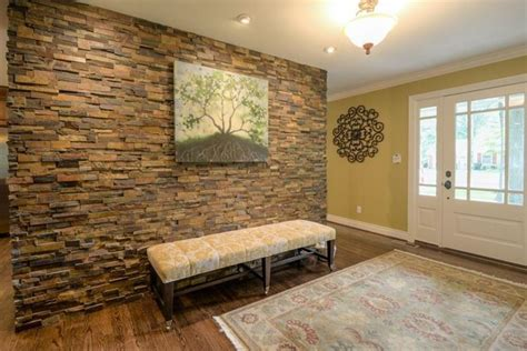 25 Amazing Stone Accent Walls. Kichens. Black Hardware. Mirrored Tile. Cypress Siding. Lowes Vanity. Lowes Dublin. Wall Clock. Cordless Lamp