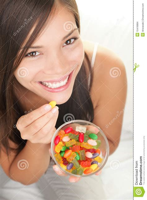 woman eating candy editorial stock image image