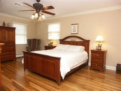 traditional master bedroom with crown molding ceiling fan