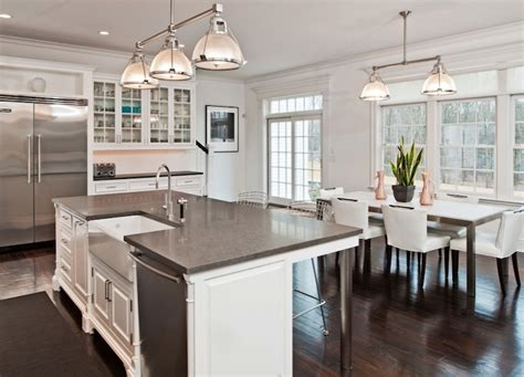 kitchen island with sink and dishwasher and seating gray granite countertops
