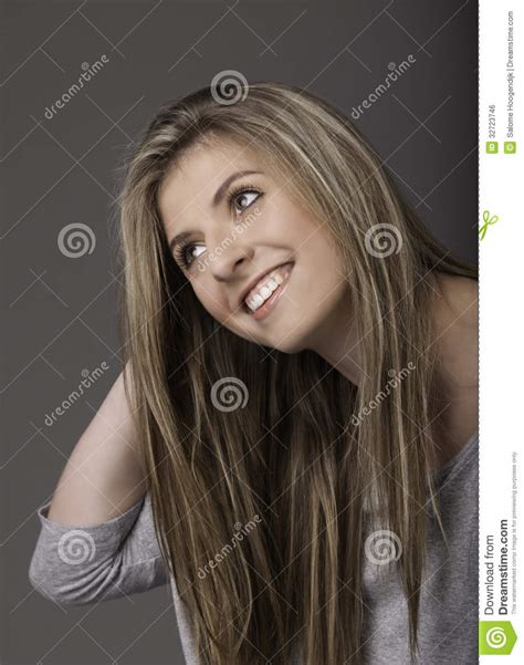 Portrait Of Beautiful Smiling Young Woman With Long Hair