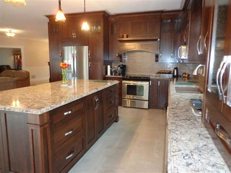 cherry wood cabinets with granite countertop stained cherry wood kitchen with light colored quartz