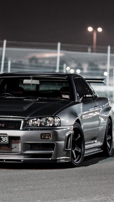 Skyline Gtr R34 Phone Wallpaper by Cars Nissan Skyline R34 Gt R Front Angle View Wallpaper