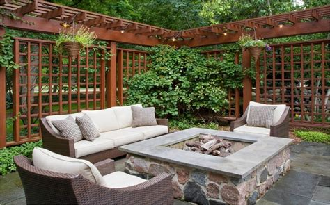 firepit with patio and pergola fence outdoor spaces
